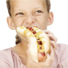 Girl eating hotdog with Parabens