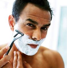 Man Shaving with Parabens Containing Foam